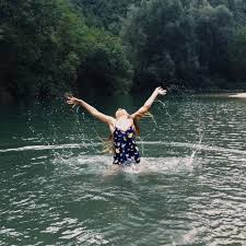 Wild swimming - happy lady