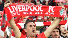 """A Liverpool's supporter holds a scarf reading """"Liverpool FC you'll never walk alone"""", prior to the UEFA Europa League final football match between Liverpool FC and Sevilla FC at the St Jakob-Park stadium in Basel, on May 18, 2016. AFP PHOTO / SEBASTIEN BOZON / AFP PHOTO / SEBASTIEN BOZON"""