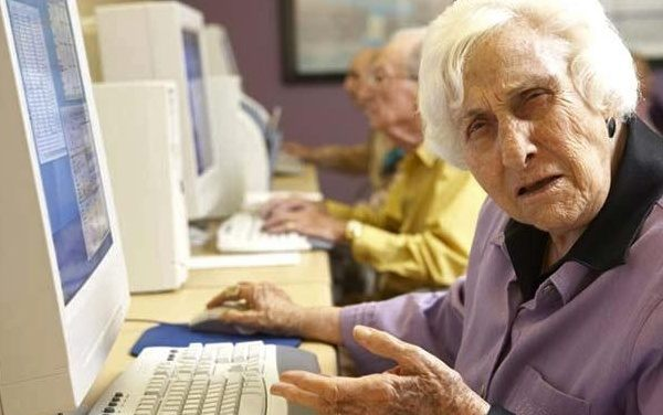old person at computer puzzled face